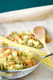 Uncooked pasta in kitchenware Royalty Free Stock Image