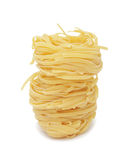 Uncooked pasta nest, isolated Royalty Free Stock Photos