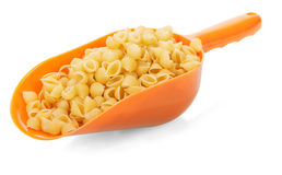 Uncooked pasta in scoop Stock Image