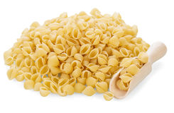 Uncooked pasta with scoop Royalty Free Stock Photography