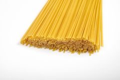 Uncooked pasta spaghetti macaroni isolated on white background Stock Images