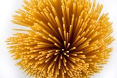 Uncooked pasta spaghetti macaroni Stock Images
