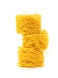 Uncooked pasta spaghetti macaroni. Isolated on white background stock photography