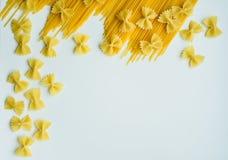 Uncooked pasta spaghetti macaroni isolated on white background Stock Image