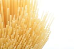 Uncooked pasta spaghetti macaroni n white Stock Images