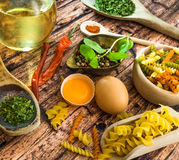Uncooked pasta and spices Royalty Free Stock Photo