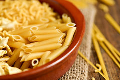 Uncooked pasta, such as ravioli, spaghetti or mostaccioli Stock Photos