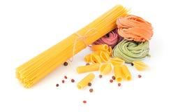 Uncooked pasta on white background Royalty Free Stock Image