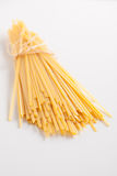 Uncooked pasta on white surface Royalty Free Stock Photo