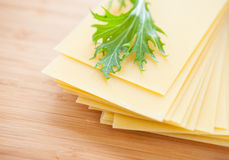 Uncooked pasta on a wooden surface Royalty Free Stock Image