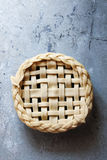 Uncooked pastry crust with lattice and leaves decoration Royalty Free Stock Image