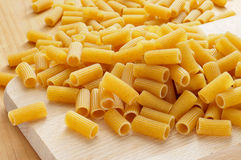 Uncooked penne pasta Stock Images