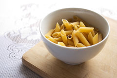 Uncooked penne pasta Royalty Free Stock Photography