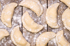 Uncooked pierogi Stock Photography