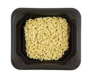 Uncooked plain ramen noodles in a black tray Stock Photo
