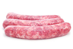 Uncooked pork meat sausages. A pile of uncooked pork meat sausages on a white background Stock Photography