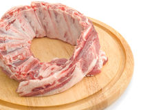 Uncooked Pork ribs on round hardboard Stock Images