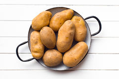 Uncooked potatoes in pot Stock Images