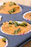 Uncooked pumpkin muffins Royalty Free Stock Images