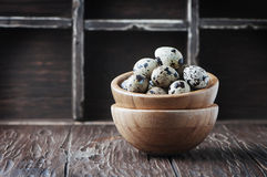 Uncooked quail eggs on the wooden table Stock Photo