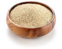 Uncooked quinoa in the wooden bowl Stock Photos