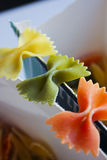 Uncooked rainbow farfalle Stock Photo