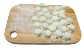 Uncooked ravioli ravioli on a wooden board Stock Image