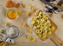 Uncooked Ravioli on a  wooden cutting board. Top view Stock Photos