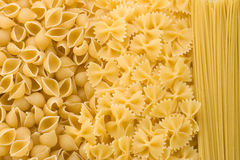 Uncooked raw pasta as background Stock Images