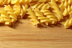 Uncooked raw pasta background on wooden background Royalty Free Stock Images