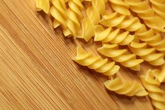 Uncooked raw pasta background on wooden background Royalty Free Stock Photo