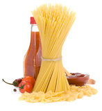 Uncooked raw pasta and food spices Royalty Free Stock Photos