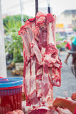 Uncooked red meat hanging on hook in Thai market.  Royalty Free Stock Photos