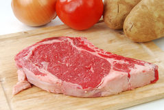 Uncooked rib eye steak Stock Photography