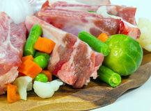 Uncooked ribs, meat and vegetables. fragment Royalty Free Stock Images
