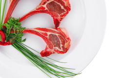 Uncooked ribs on plate Royalty Free Stock Images