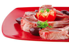 Uncooked ribs on red plate Stock Photo