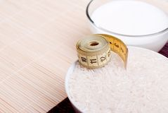 Uncooked rice on board diet food. Uncooked rice  board diet food Royalty Free Stock Photos
