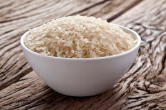 Uncooked rice in a bowl Stock Photography