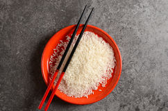 Uncooked rice in a bowl Stock Photo