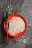 Uncooked rice in a bowl Stock Images