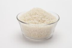 Uncooked rice in bowl with... Royalty Free Stock Image