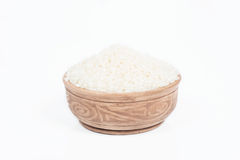 Uncooked rice in a dish Royalty Free Stock Photography