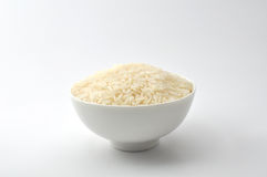 Uncooked rice, jasmine rice, mali rice,Thai jasmine rice in a white bowl ceramic on white background. Stock Photography