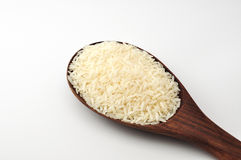 Uncooked rice, jasmine rice, mali rice,Thai jasmine rice in a wood ladle on white background. Royalty Free Stock Photos