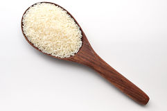 Uncooked rice, jasmine rice, mali rice,Thai jasmine rice in a wood ladle on white background. Stock Images