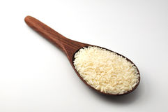 Uncooked rice, jasmine rice, mali rice,Thai jasmine rice in a wood ladle on white background Royalty Free Stock Photo