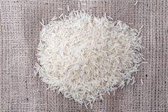 Uncooked rice is scattered Royalty Free Stock Image