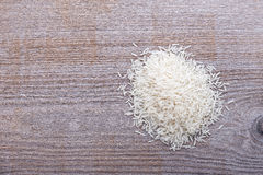Uncooked rice is scattered Stock Photography