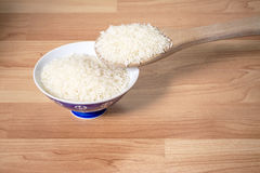 Uncooked rice in a serving bowl Royalty Free Stock Photos
